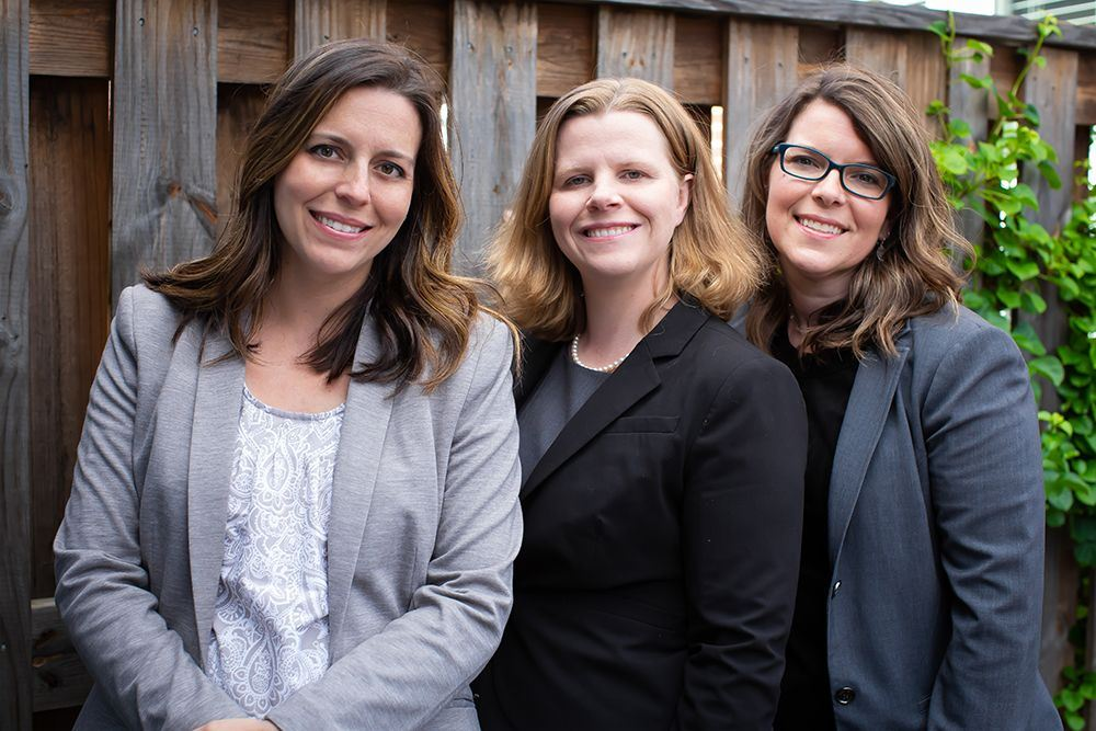 Photo of three attorneys - Katherine C. McCollam, Jessica H. Foster, and Catherine Carré
